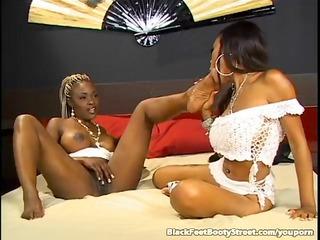sweet ebon lesbos licking feet