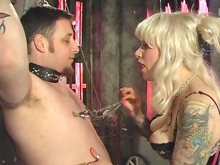 guy in bondage obeys orders from blonde
