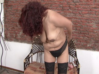 bulky aged latin chick playing with herself