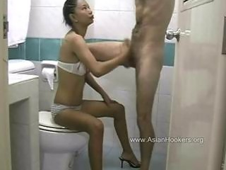 thai hooker sucks rod in the wc