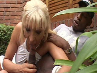 golden-haired shemale stuffed with darksome pecker