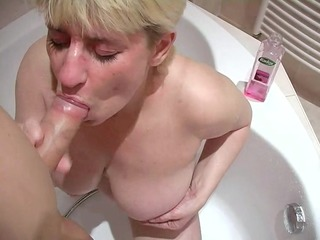 breasty older broad sucks a chunky penis