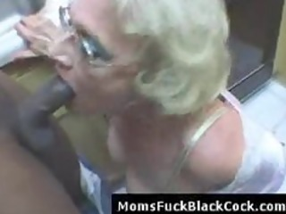 very older white lady blows large darksome