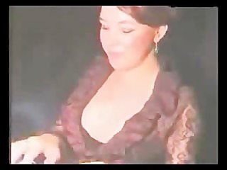 slut smokes cigarette whilst engulfing a sex toy