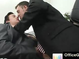 hot spruce homo men at office giving a kiss
