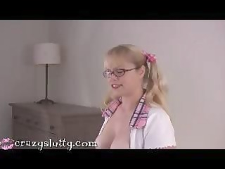breasty lascivious blond geek in glasses eats his