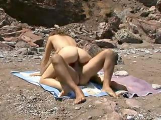 concupiscent beach voyeur couple...