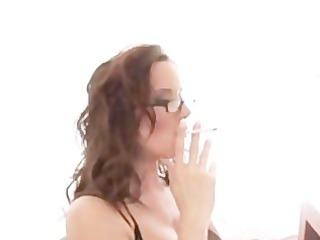 charming brunette hair gives smokin irrumation in