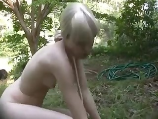 bound up blond doxy abased in the forest
