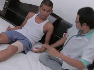 homo doctor taking advances on cute oriental lad