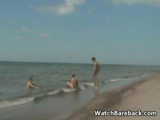 homosexual trio beach oral job