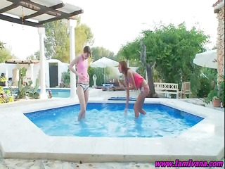 a pair of lesbian babes play in the pool and rub