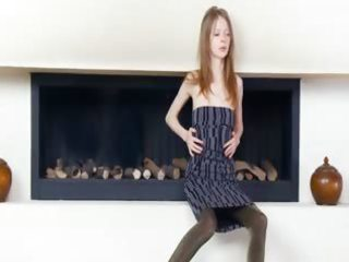 divinely slim angel by the fireplace