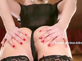 domme in red petticoat and dark shirt