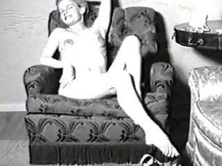 vintage porn movie scene of a lady in nylons