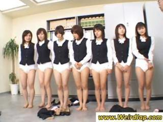 group of asian legal age teenagers pose in a line