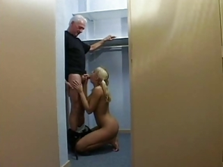 golden-haired prisoner blows an old dude and