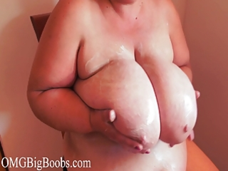 mommy daphne puts lotion on her huge scoops