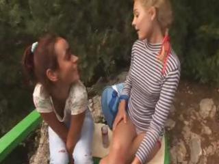 legal age teenager lesbos are outside and play