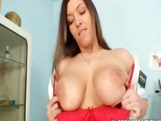 nurse andrea masturbating with large sex-toy and