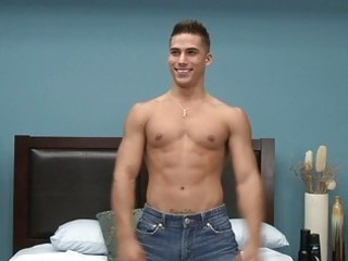 muscled homosexual porn star doing a striptease