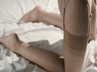 sleek sweetheart in nylon jerking off dong