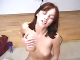 nice-looking brunet rides a sybian