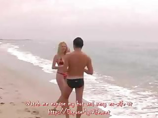 on a secluded beach with nobody around a blond