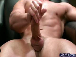 muscled guy stroking his jizzster