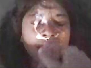 swarthy acquires her face overspread with cum