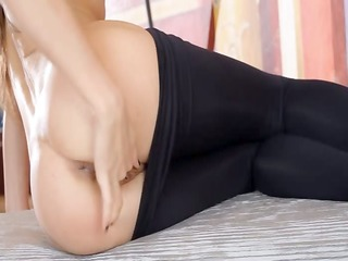 stretching her anal with metallic sex toy