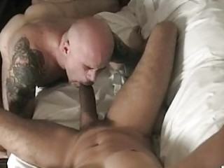 tattoed muscled homo engulfing a dick
