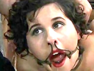 hogtied brunette hair receives tortured