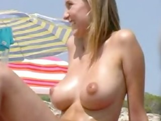 blond chick with wonderful wobblers on the beach