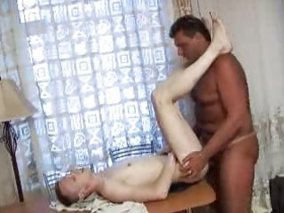 large fellow drilling boys arsehole on the table