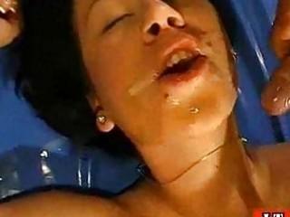 Bukkake brunette takes sperm bath at bizarre