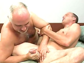 aged homosexual gives younger hunk a cook jerking