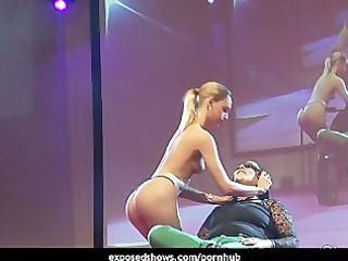 hawt blond playing with her male fan on the stage