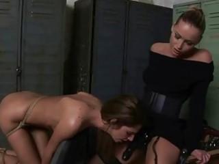 chic domina punishing sexy girl